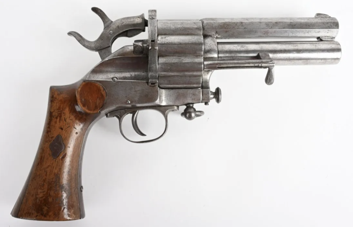 Rare center-fire cartridge Le Mat revolver, 13mm/20 gauge, manufactured 1877-1883 in Belgium. Nine-shot fluted cylinder with 20-gauge shotgun in center. Very fine example with crisp action. One of five known examples.