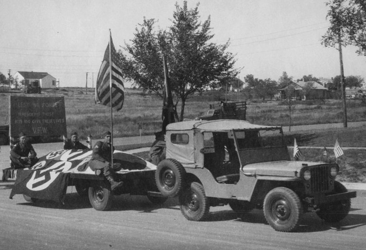 Following WWII, the new civilian CJ2A was competing for sales with war surplus MBs. VFW parade in Cimaron, Kansas, 1945
