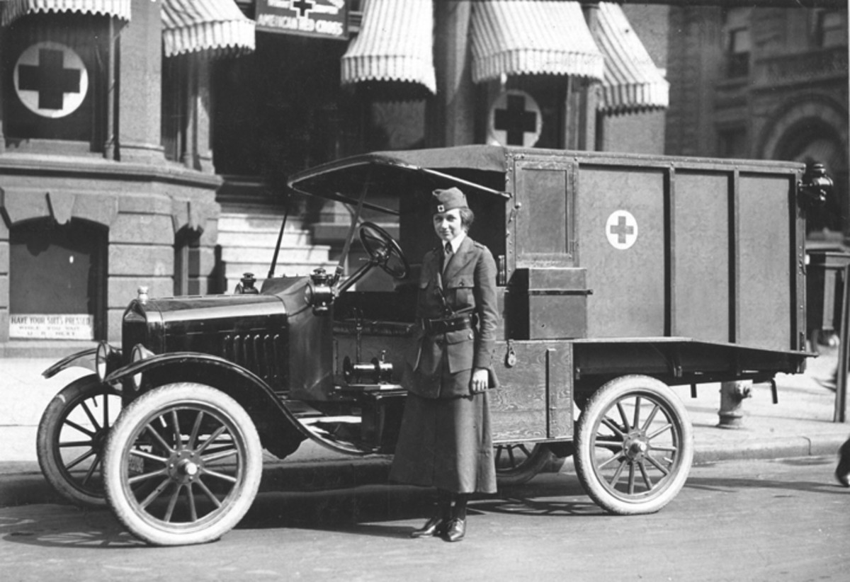 Motor Red Cross woman with Model T ambulance