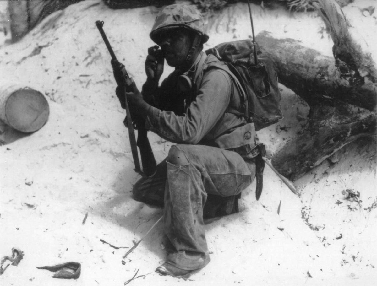 Initially, the M1 and M1A1 carbines were produced without any capacity to attach bayonets. Soldiers who carried a carbine were generally provided with an M3 knife to supplement their combat readiness. Photographed on Tarawa, Gilbert Islands, in November 1943, this Marine radio operator is armed with an M1 carbine with no provision for a bayonet.
