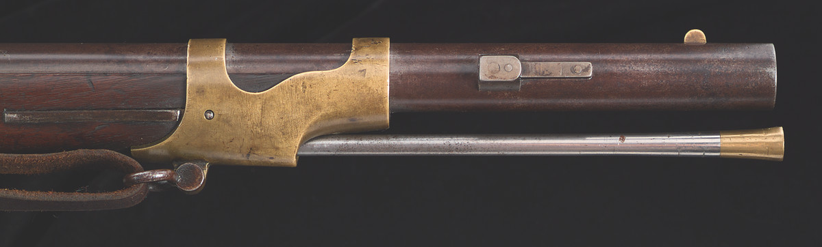 The Maine alteration is characterized by a bayonet lug attached to the left side of the barrel with one large pin and two small pins.