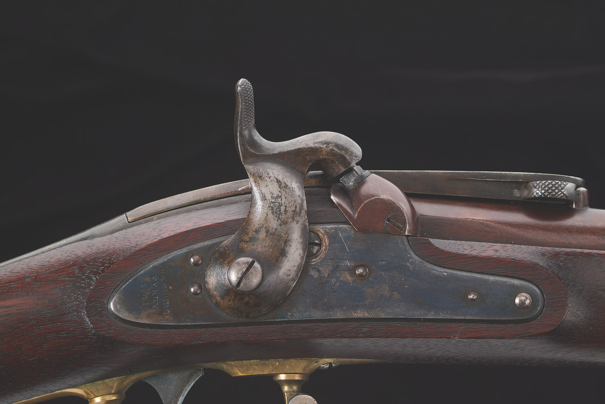 Early in the Civil War a few U.S. Model 1841 Rifles were altered with the addition of the Merrill breech apparatus. The lock plate hasan additional screw. The bolster has a clean out screw.