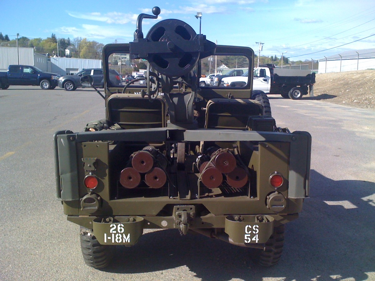 Rearview of M38A1C Jeep showing stored 106mm rounds.