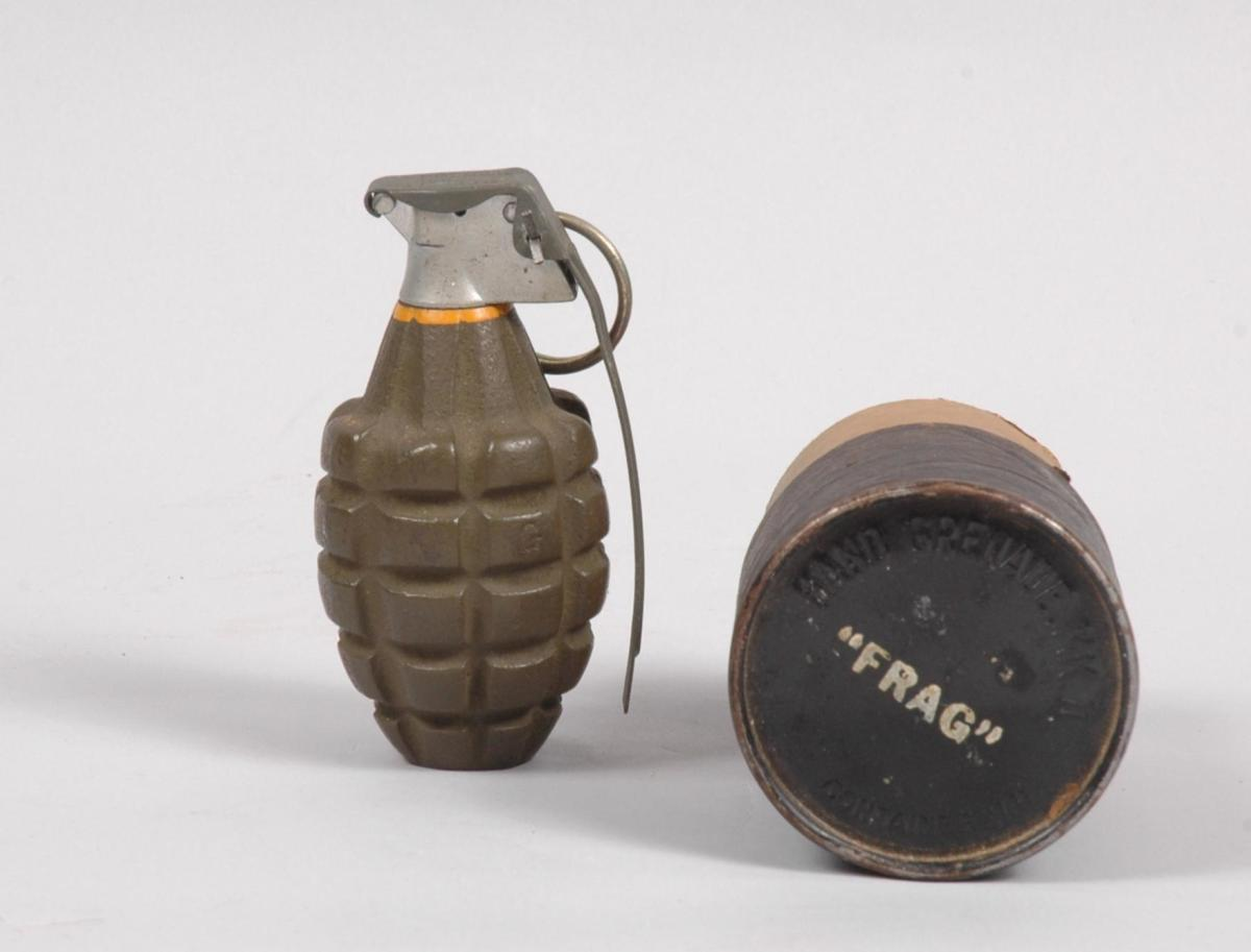 "The classic MK-II ""pineapple"" grenade went to Vietnam with the first U.S. troops in the country. This was to be the last large-scale use of the WWII-veteran piece of ordnance. The grenades were packed in cardboard tubes as seen here to the right."