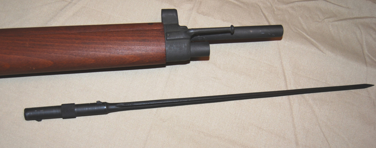 The MAS-36 carried a 17-inch spike bayonet, reversed in a tube below the barrel. To use the spike bayonet, the rifleman pressed a spring plunger to release it. He could then pulled it out, turn it around, and fit it into its receptacle — ready for action.