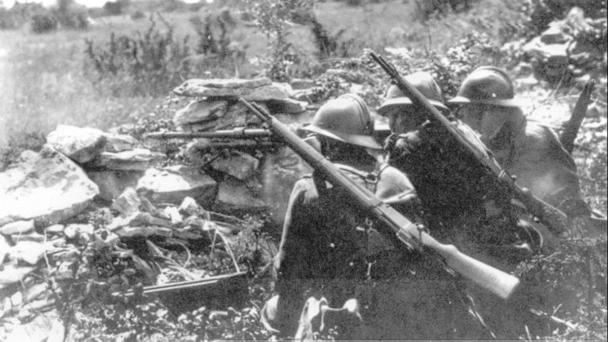 The MAS-36 was meant to be an economical, bolt-action rifle for rear echelon, colonial, and reserve troops. These French soldiers in the early days of the WWII are carrying the compact MAS-36 on their backs. It was normally carried with a loaded magazine and empty chamber until the soldier was engaged in combat.