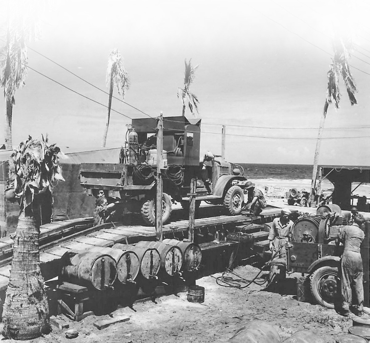 Whether it is a common chore for you or brand new, servicing your oil filter is essential and not something you can overlook. These WWII Seabees on Eniwetok realized how important it was to service their vehicles, so they created this clever, makeshift grease rack.