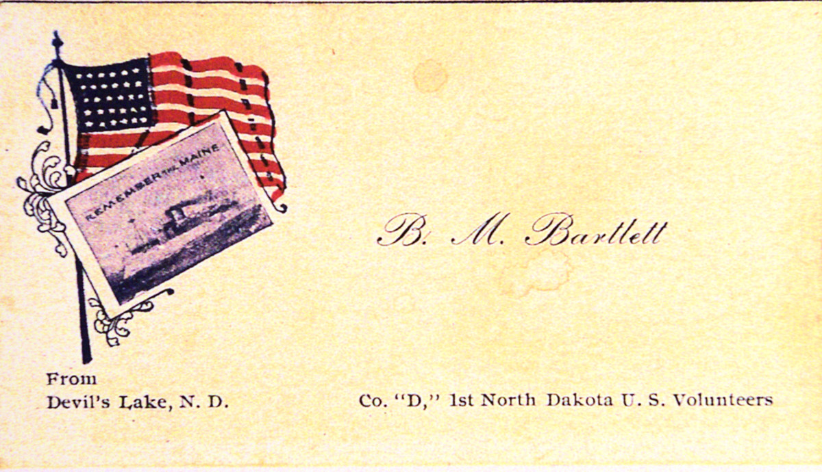 """Bert's patriotic calling card with flag and """"Remember the Maine"""" commemorated his service with the First North Dakota."""