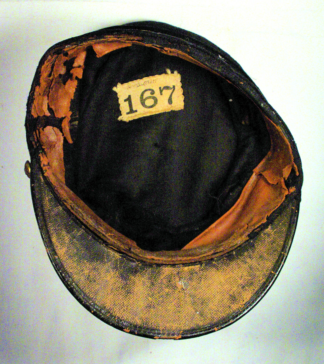 The interior of the well-worn kepi is lined with black cloth. The cloth label shows Bert's name written in ink.