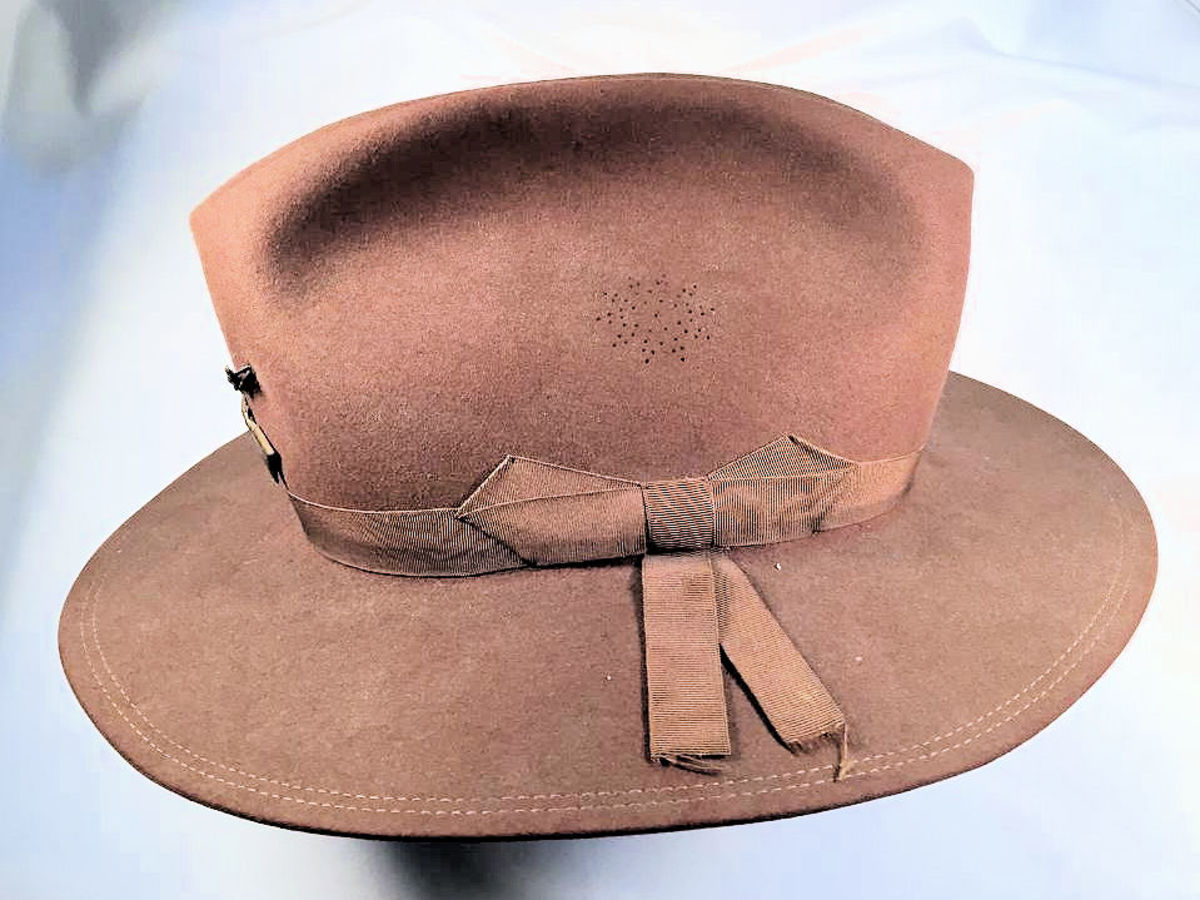 This side view reveals the snowflake pattern vents of the 1889 pattern hat. These replaced the brass vents found on the earlier 1883 pattern hat.