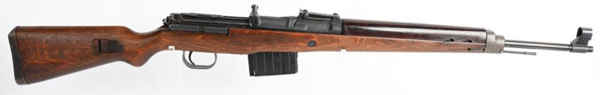 Outstanding World War II German Walther K-43 rifle, manufactured in 1945, fine laminated wood stock, Bakelite handguard. Sold for $7,200 against an estimate of $3,000-$4,000