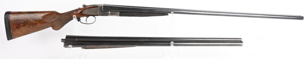1913 L.C. Smith crown-grade 20-gauge ejector gun with both a 26-inch and 32-inch barrel. Made to order by Hunter Arms Co., Fulton, N.Y. One barrel is marked 'Sir Joseph Whitworth Fluid Compressed Steel.' Sold for $24,000 against an estimate of $3,000-$4,000.