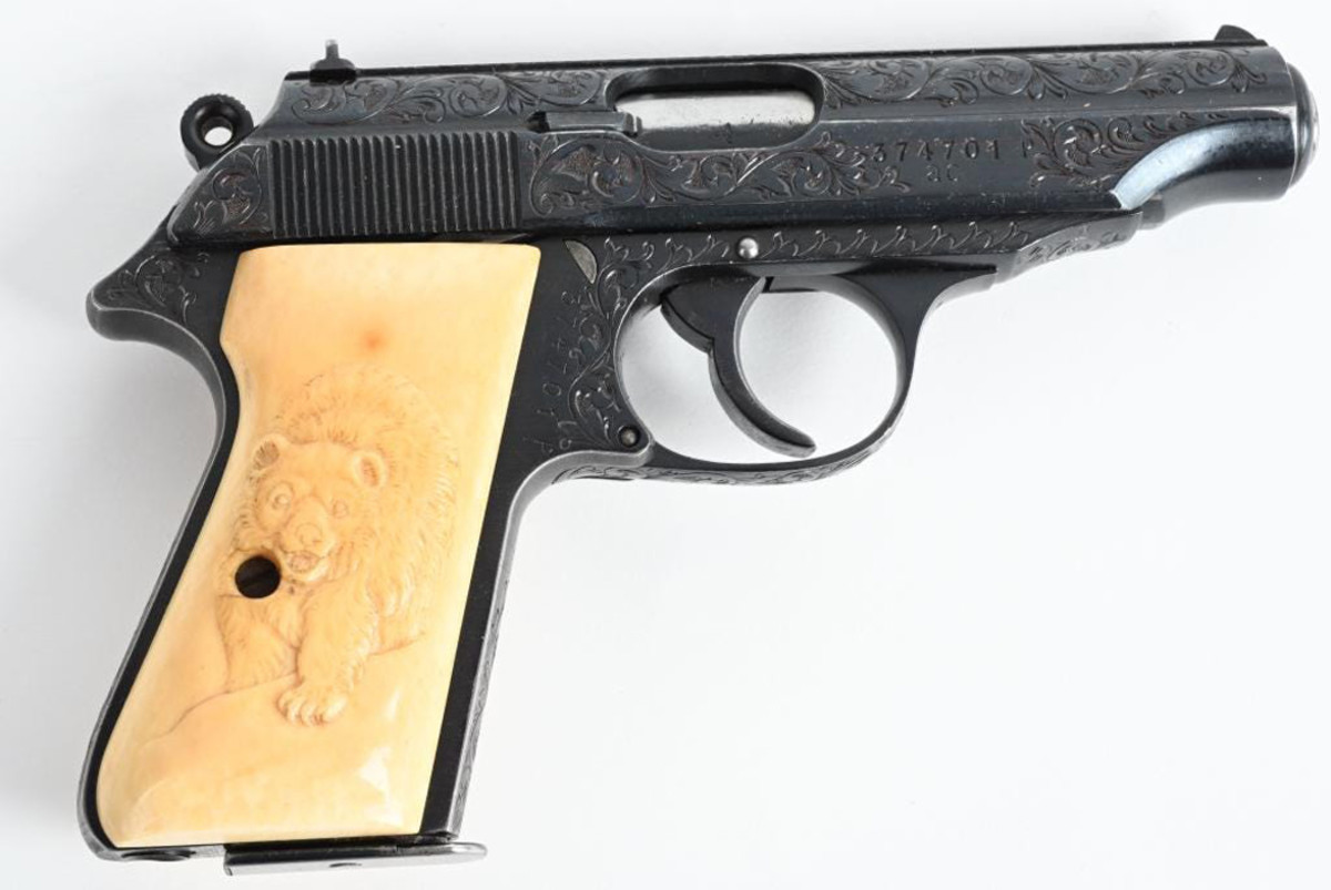 Walther AC PPK pistol, 7.65 caliber with Nazi eagle on barrel. Carved bone grips. Accompanying family letter attests gun was brought to USA from Adolf Hitler's mountain retreat 'Eagle's Nest' by soldier and retained by the family ever since. Sold for $16,800 against an estimate of $3,500-$4,500.