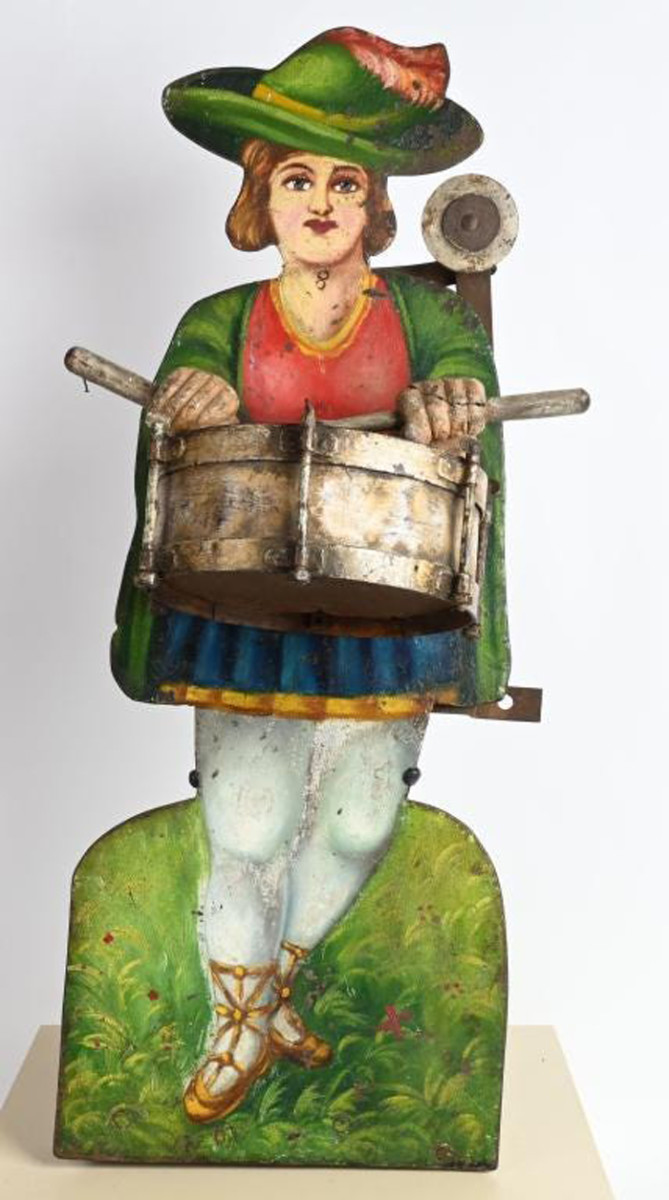 1880s hand-painted figural iron shooting gallery target depicting drummer with carved-wood hands. When target above shoulder is hit, figure plays drums. Provenance purportedly includes display at Frazier History Museum in Louisville, Ky. Sold for $27,000, more than four times the high estimate.