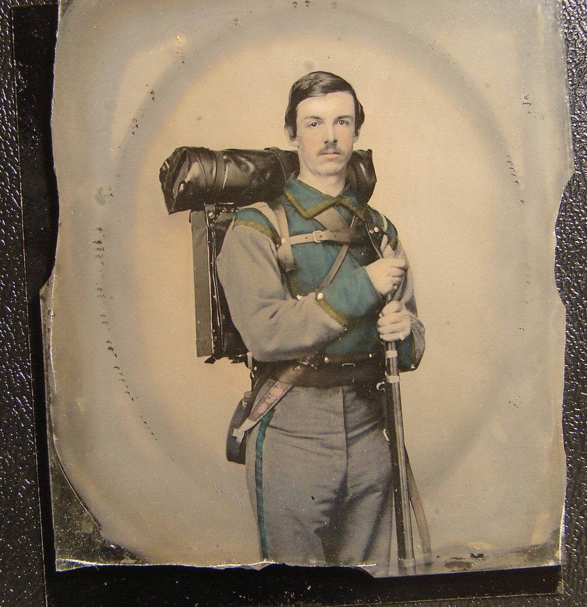 """Unidentified soldier in Confederate uniform of Company E, """"Lynchburg Rifles,"""" 11th Virginia Infantry Volunteers holding 1841 """"Mississippi"""" rifle."""