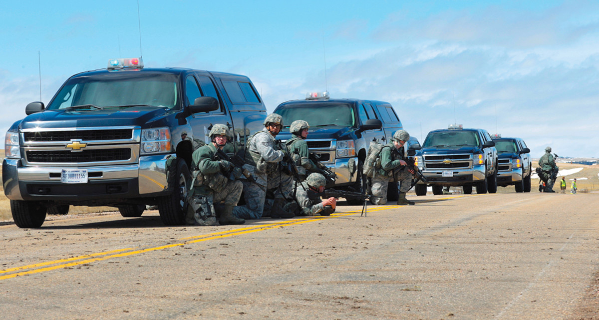 90th Security Forces Group defenders tactically position themselves along side their Chevrolets during an inspection of the 90th Missile Wing on F.E. Warren Air Force Base, Wyoming, April 12, 2013. U.S.