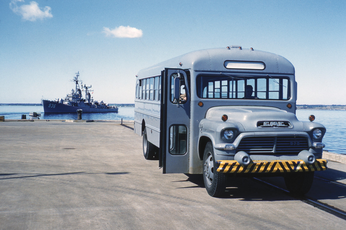 """A US Navy GMC bus in """"battleship gray,"""" photographed in 1958."""