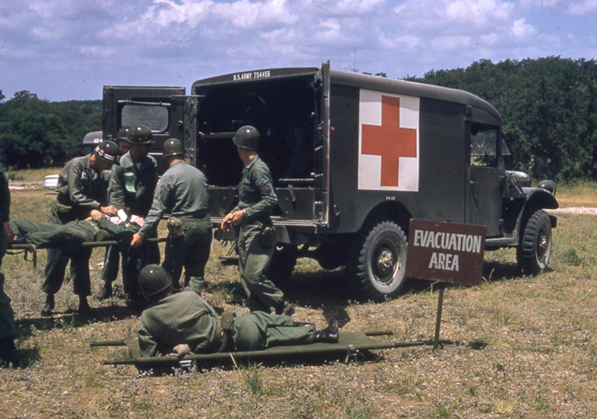 Ca. 1958 photo showing an evacuation drill using an M43 ambulance.
