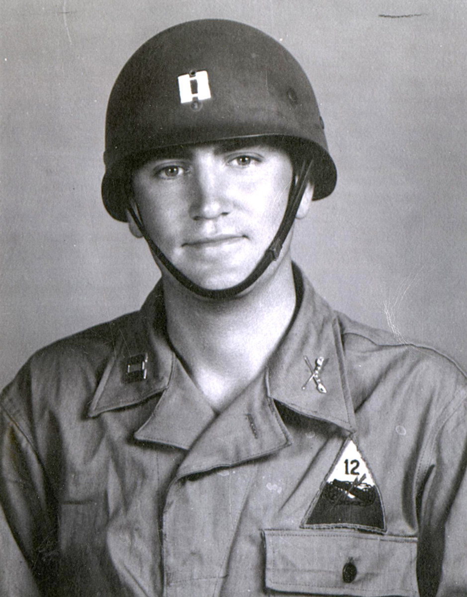 Captain Russell Ernst, Troop Commander, Troop C, 92nd Recon Squadron, 1943 wearing a helmet liner with the leather chinstrap in place.