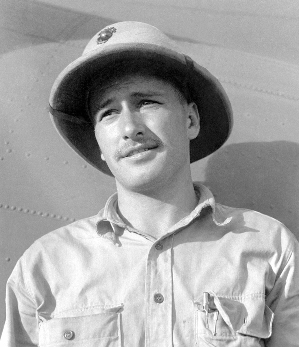 United States Marine Corps Captain (CPT) Gregory K. Loesch wearing a pressed fiber helmet.