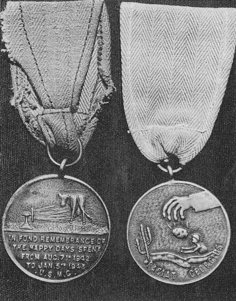 "The medal on the left was produced from the second mold and states, ""IN FOND REMEMBRANCE OF THE HAPPY DAYS SPENT FROM AUG. 7th 1942. TO JAN. 5th 1943 U.S.M.C."" The medal on the right, produced from the first mold, is slightly smaller. The ""FACIAT GEORGIUS"" is Latin for ""Let George Do It."" Both medals are suspended from ""ribbons"" made from the Marine herringbone utility uniform."