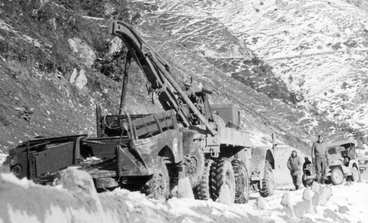 The Series Four Ward LaFrance Model 1000 is readily identifiable by the curved boom of the Gar Wood US5G crane, in place of the US5 straight boomed crane previously used. These trucks, built in 1943, also had the enlarged fuel filler to accommodate field refueling with jerry cans.