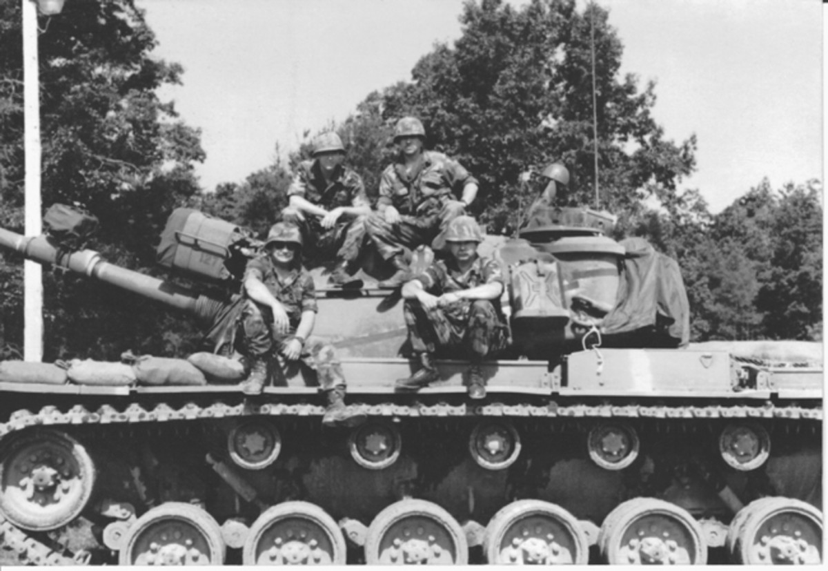 Troop A, 237th Cavalry Ohio National Guard crew on a MATS M-48A5. On the turret, left to right, PFC Matt Owens; Sp4 Ken Gregg, loader and gunner; Dan Wolverton, SSgt and Plt Sgt 1st Platoon; and Sp4 Phil Brunner, driver and a Vietnam tank commander. Photo taken at Grayling, Michigan.