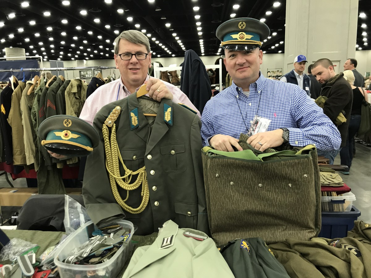 Collectors and dealers of East German militaria, Kevin Born and Paul Madden.