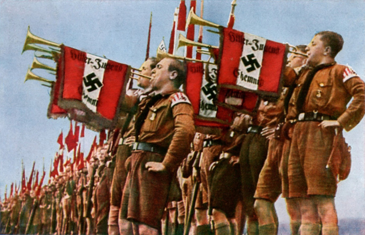 Hitler Youth trumpet in a ceremony.