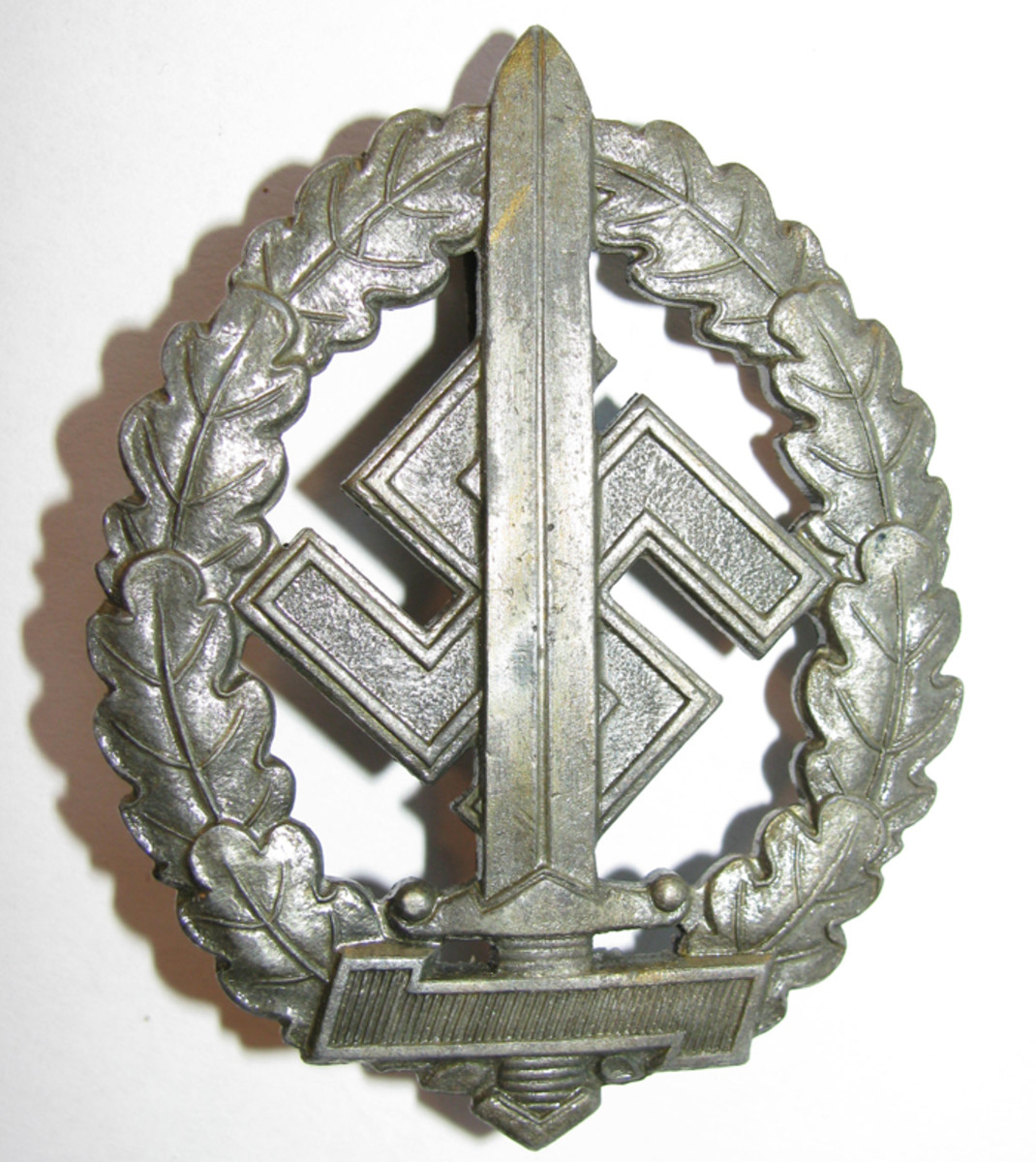 """The SA badge for war wounded included a horizontal """"Wolfsangel"""" rune across the bottom."""