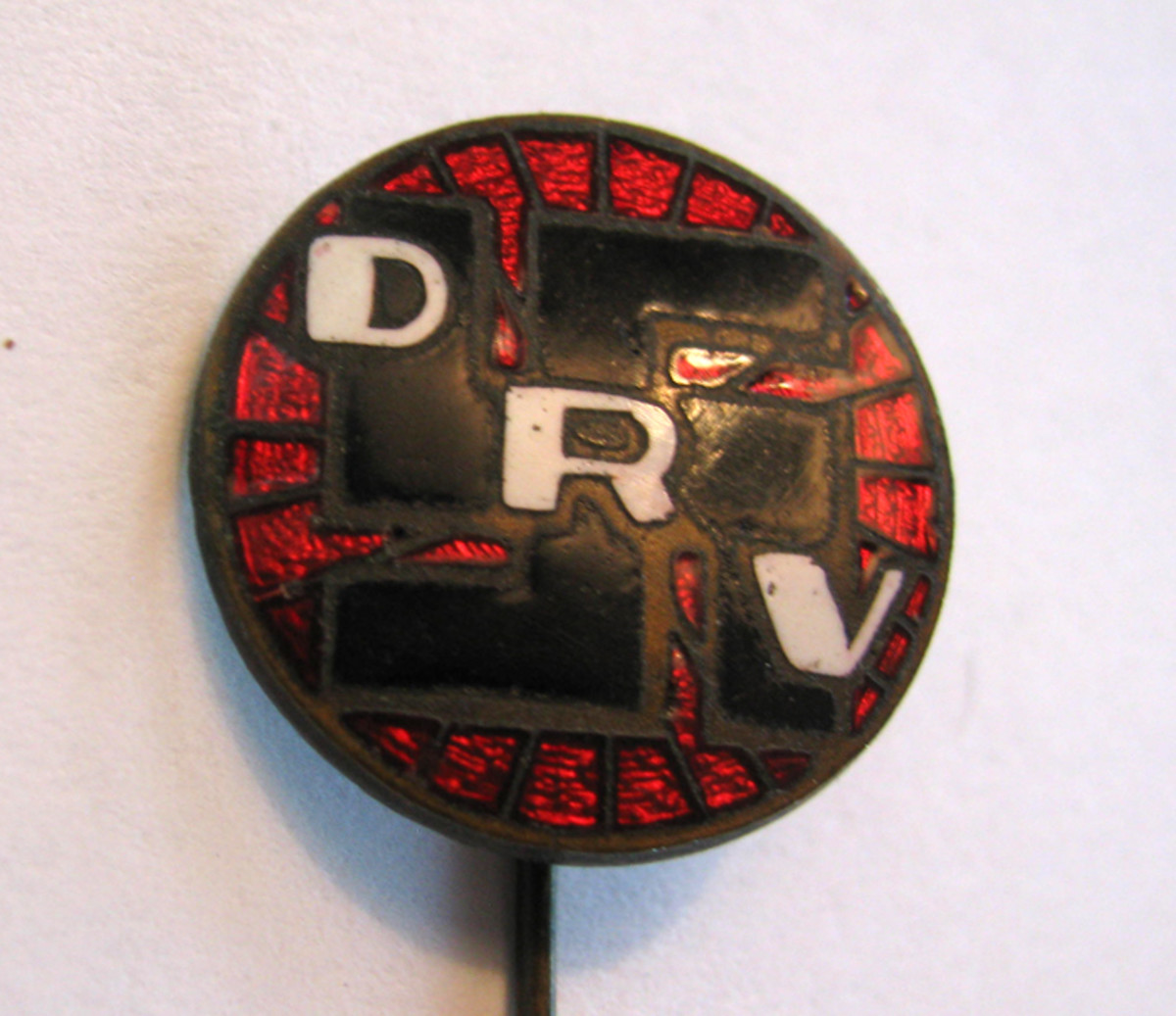 The DRV, German bicycle Association pin was a wheel supporting the club's initials.