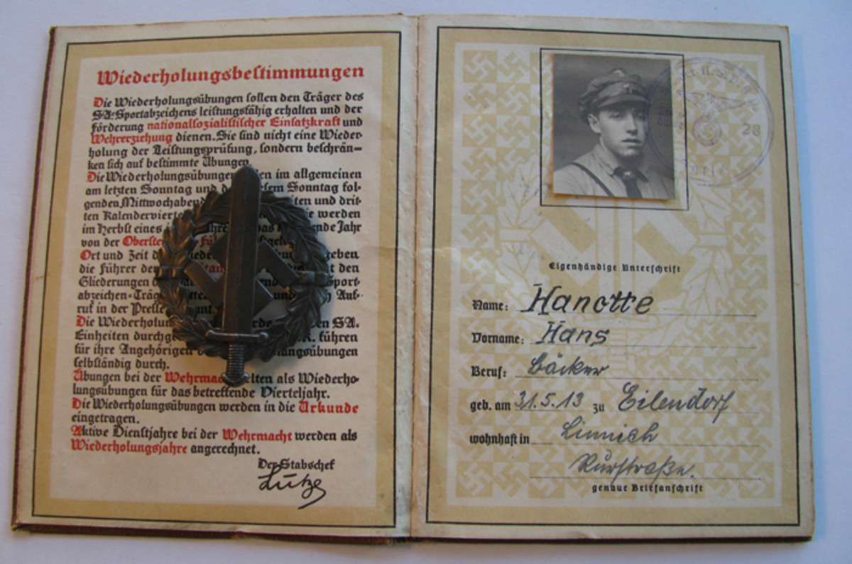 """Hitler Youth Hans Hanette earned the bronze SA badge and received his award """"Urkunde"""" (certificate) book and badge."""