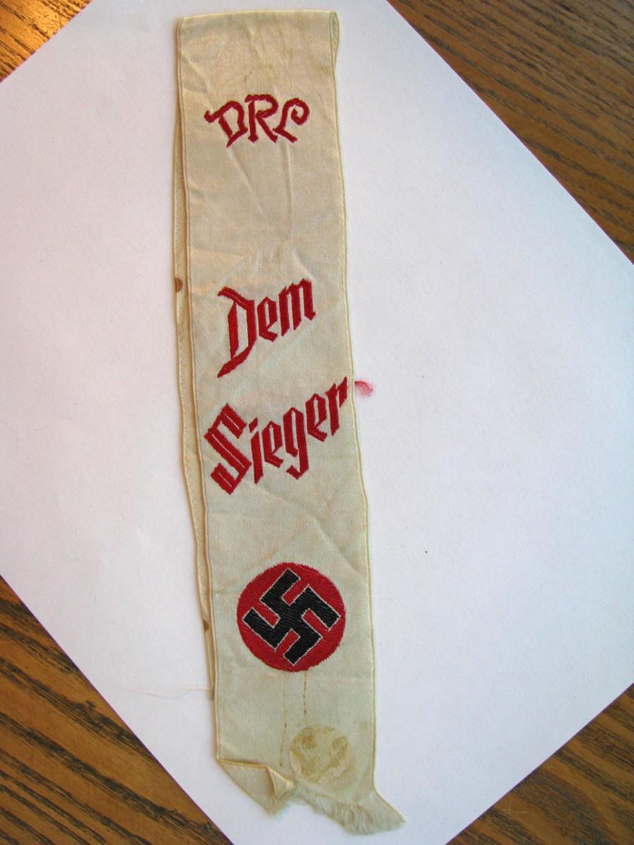 "DRL ribbon proclaiming, ""Dem Sieger"" — the winner."