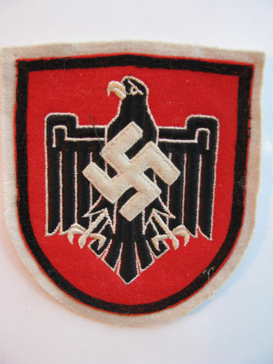 The 1936 German Olympic athletes wore colorful shields of the NSRL.