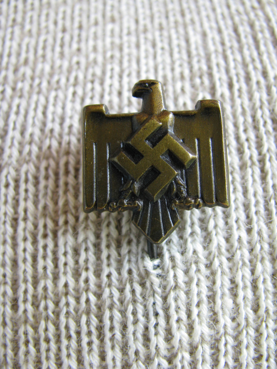 A 1938 Breslau gymnastic meet badge sported the NSRL eagle in its center, as did the regulation NSRL membership pin.