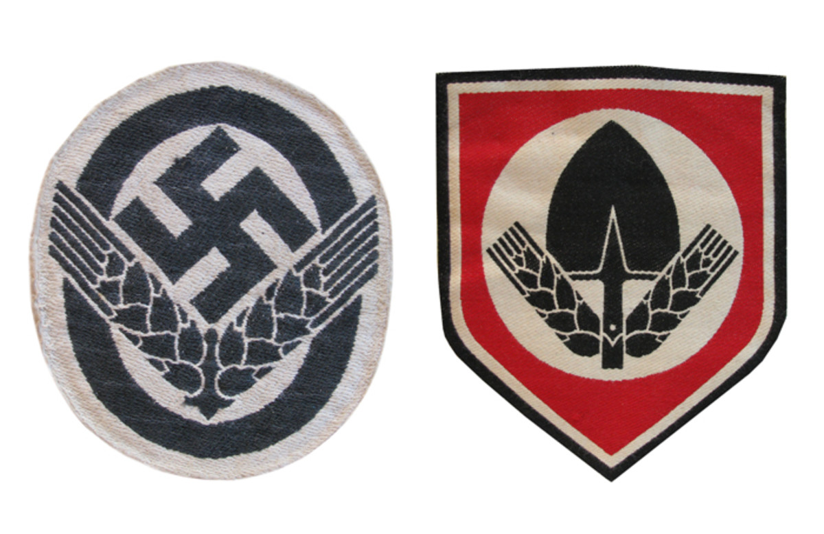 The RAD members wore sports vest patches, a spade emblem for the men and wheat sheaves for the women.