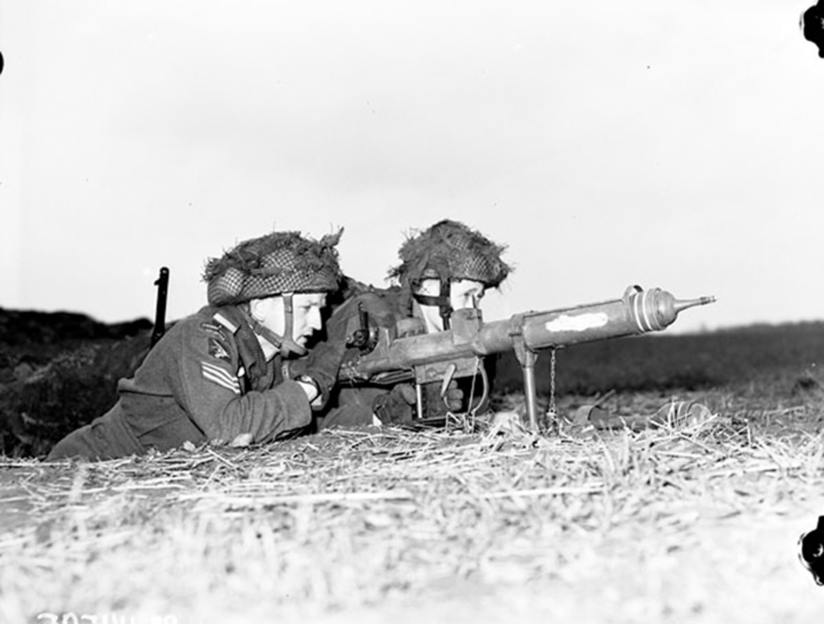 A staged image shows two British paratroopers readying a PIAT Gun. The weapon did well against German and Italian tanks, but soldiers needed to get close to make the kill shot.