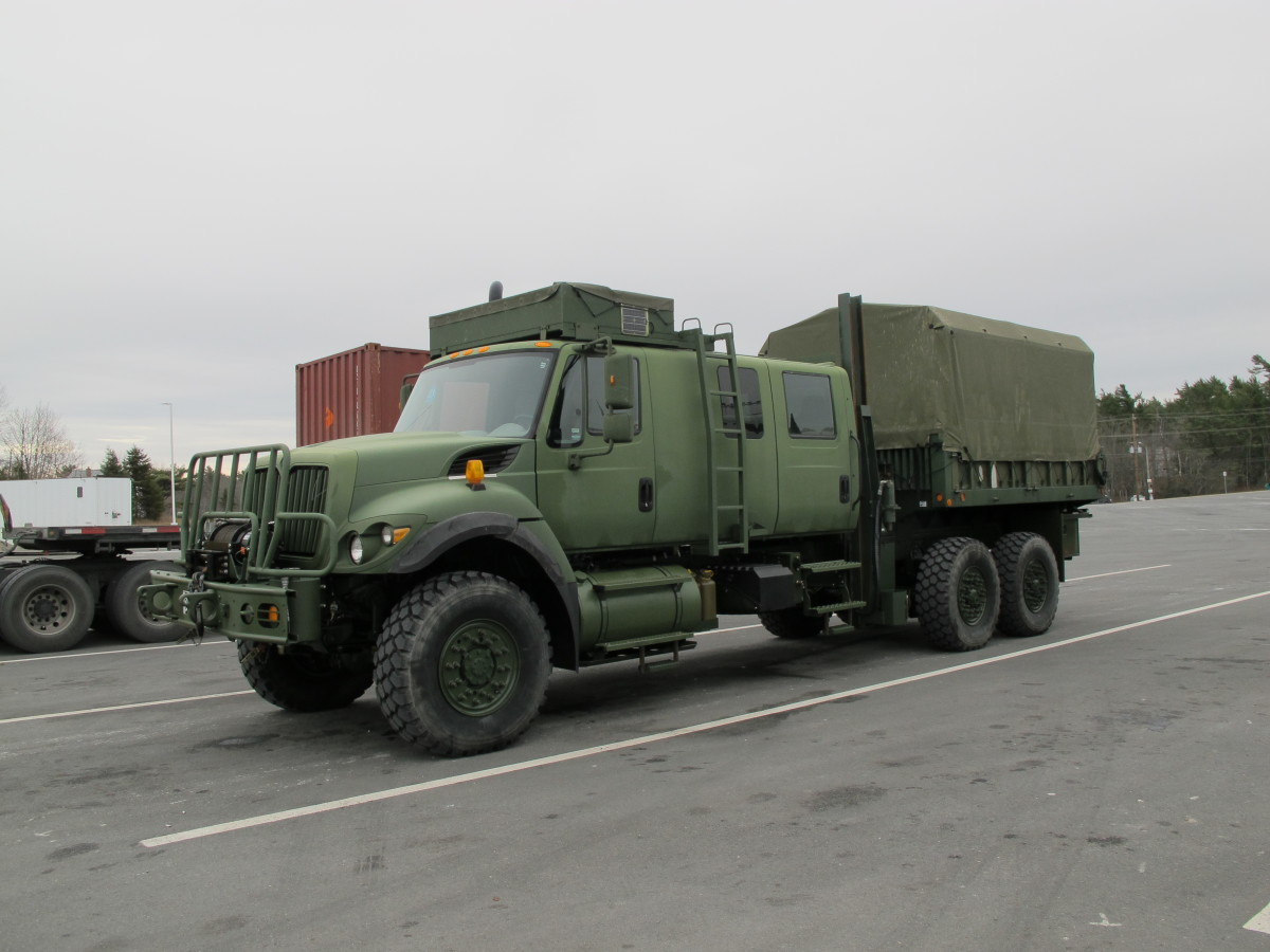 This Canadian Armed Forces Navistar 7000 has an unusual 9-passenger cab. A crane is mounted between the cab and the box.