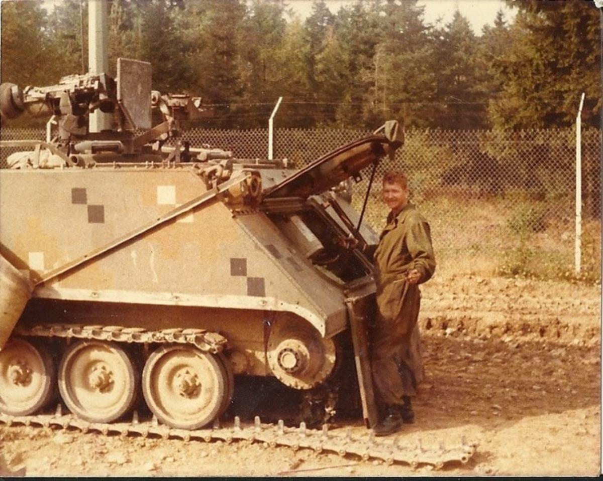 Dual-Tex painted M113 undergoing track repair