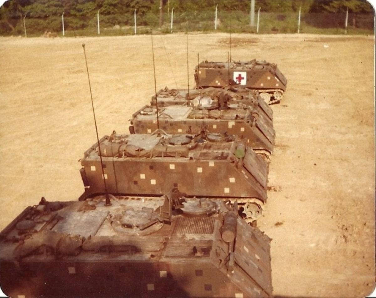 Dual-Tex M113s including an ambulance.