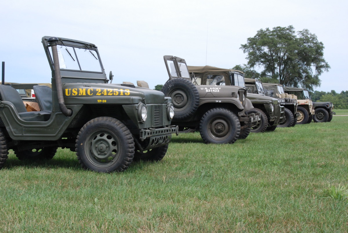 Line up of jeeps that include an M422 Mighty Mite, M38A1, M151, and an M151A2