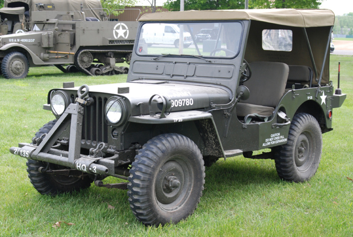 M38 Jeep with distinctive headlights with guards and gas filler cap near the driver's seat.