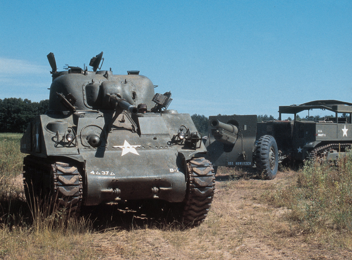 M4A3 Sherman with an M5 High Speed Tractor pulling a 105mm howitzer.