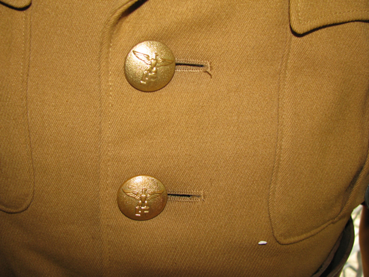 Detail on political leader buttons showing the static swastika with eagle above.