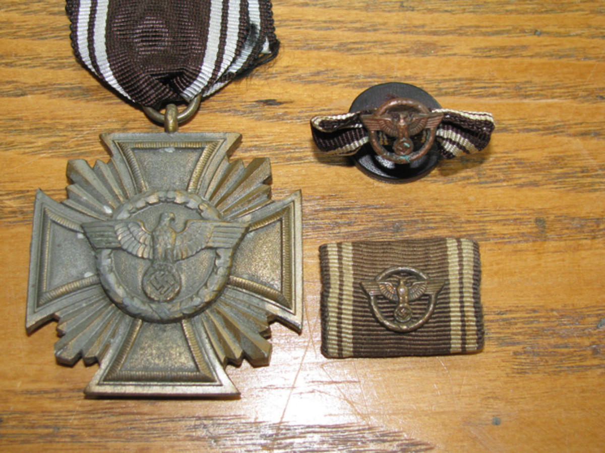 Many political leaders would have worn a 10 year NSDAP service award in one of the forms shown.