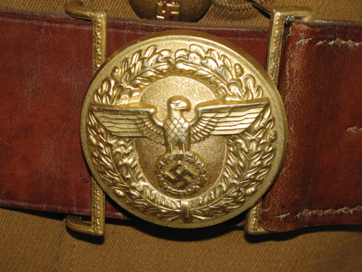 The political leader round buckle was a beautiful piece with its brown belt and matching keeper.