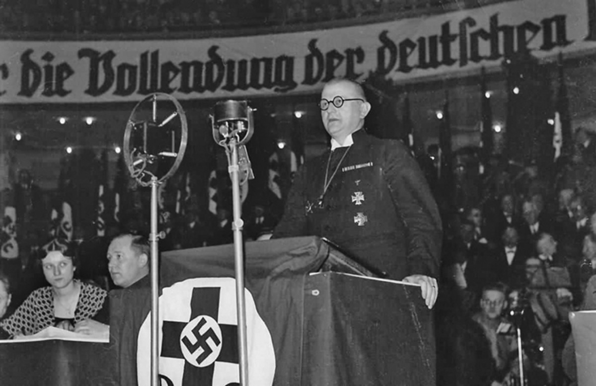 The German Christians, an anti-semitic and racist pressure group and Kirchenpartei, gained enough power be able to install Ludwig Müller to the office of Reichsbischof in the 1933 church elections. The German Evangelical Church Confederation was subsequently renamed the German Evangelical Church. In 1934, the German Evangelical Church suffered controversies and internal struggles that led to forming a single, unified Reich Church compatible with Nazi ideology for all of Nazi Germany. Ludwig Müller, the leader of the Reich Church,is shown above speaking at a public event.