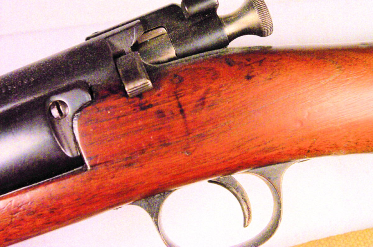 The stock of the PC rifle has no trace of any arsenal or inspector marks stamped in the wood.