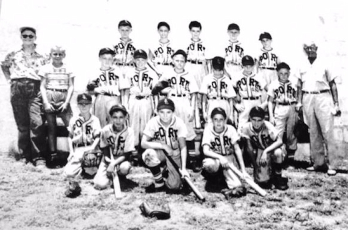 "In 1949, Edwin Parsons became the coach of Sarasota, Florida's Little League Sports Association team. He is at the far right of the top row. The author, who was embarking on his own ""Great Adventure,"" is in the middle of the front row, kneeling with a bat in hand."
