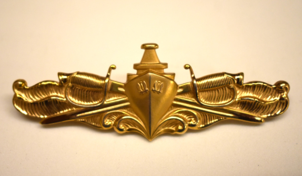 Buell's Surface Warfare Officer Badge indicated his qualification as an Officer of the Deck.